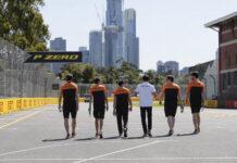 Carlos Sainz, McLaren, walks the circuit with colleagues