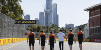 Carlos Sainz, McLaren, walks the circuit with colleagues